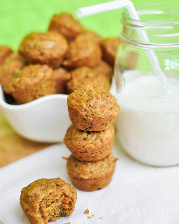 Mini Veggie Muffins -- loaded with carrots, zucchini, & whole wheat flour -- make a yummy, healthy breakfast or snack for toddlers, kids, and adults alike! | FiveHeartHome.com