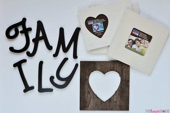 Family Lettering Wall Decor Uses Picture Frames And Wooden Letters Backed With Sbook Paper