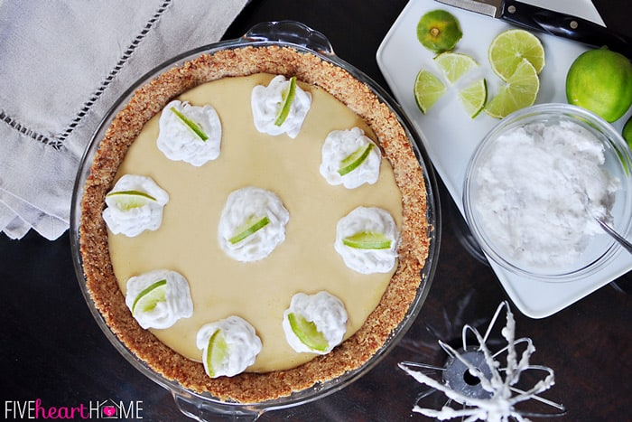 Key Lime Pie with a Pretzel Crust topped with dollops of Coconut Whipped Cream