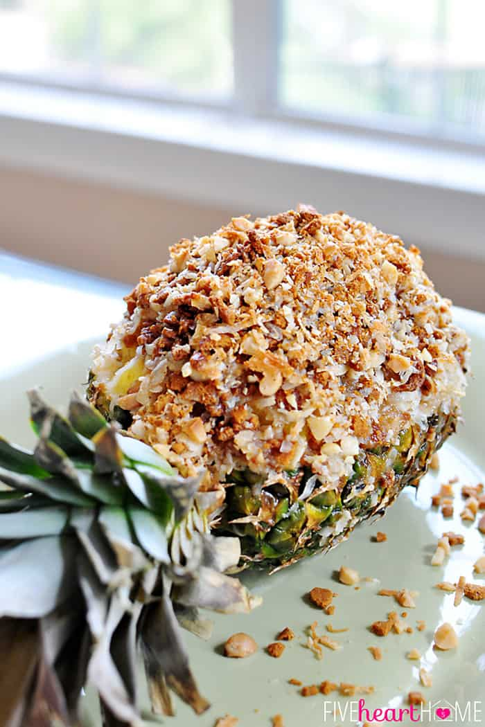 Pineapple Au Gratin ~ a pineapple topped with shredded coconut, crushed gingersnaps, & macadamia nuts, then drizzled with coconut milk and baked until hot & bubbly   {Five Heart Home}