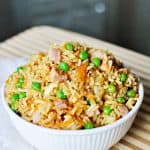 Easy Fried Rice in a white bowl in a wooden cutting board