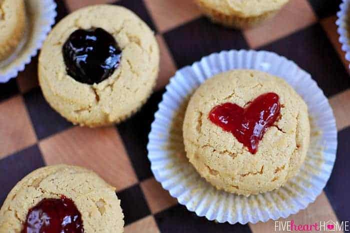 Aerial view of muffins with red jelly shaped in a heart on one of them