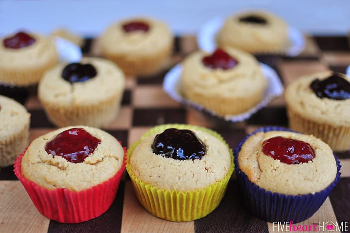 Row of Peanut Butter Muffins, filled with jelly and wrapped in red, yellow, and blue paper liners