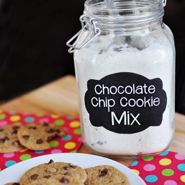 Jar of Chocolate Chip Cookie Mix with plate of fresh cookies.