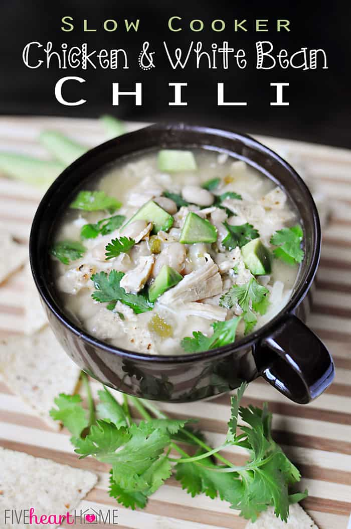 Slow Cooker White Bean Chicken Chili ~ after bubbling away in the crock pot all day, this comforting soup -- loaded with tender chicken, white beans, and tangy green chiles -- is topped with your favorite garnishes: fresh cilantro, crunchy tortilla chips, gooey cheese...the possibilities are endless! | FiveHeartHome.com via @fivehearthome