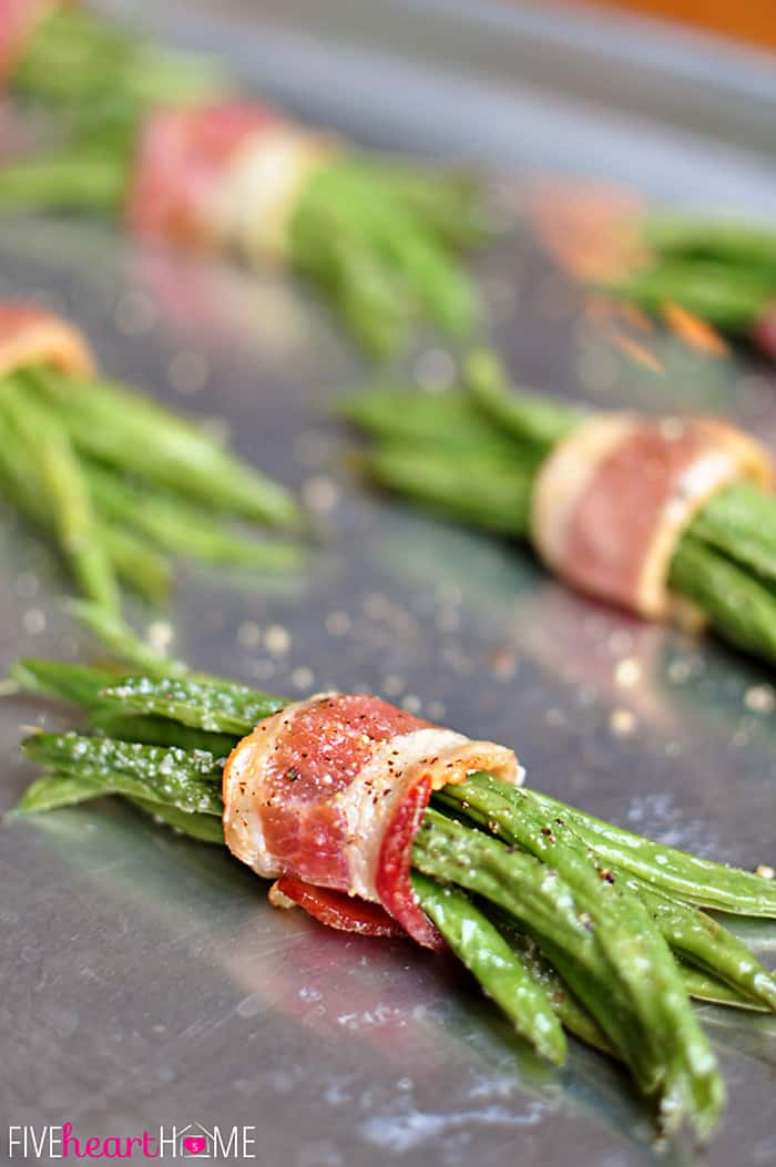 Close-Up of Sinlge Bacon Green Bean Bundles with Brown Sugar Glaze on Baking Sheet