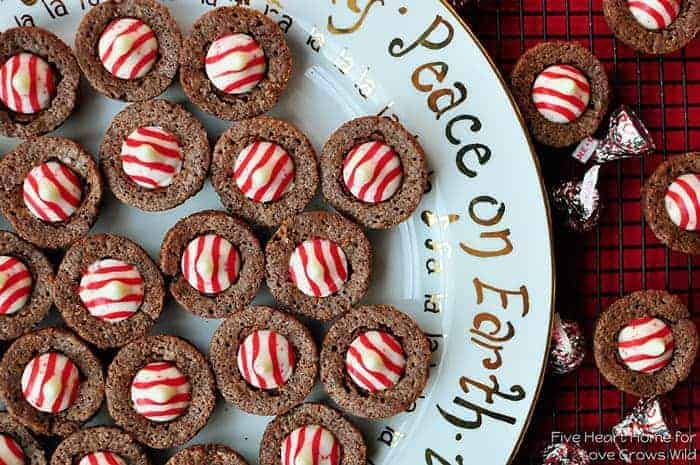 Aerial photo of a Christmas platter of brownie bites topped with red and white striped Hershey's Kisses