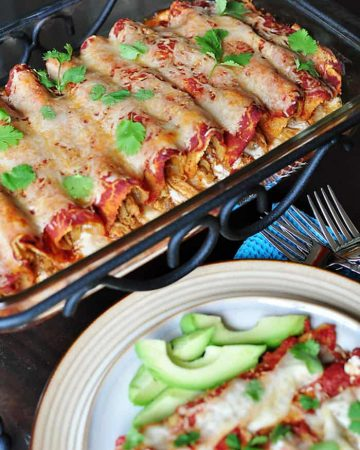 Creamy Chicken Enchiladas in baking dish and on plate.