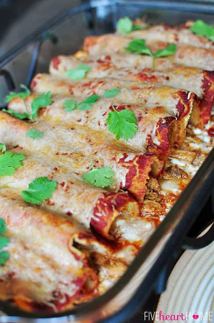 Creamy Dreamy Chicken Enchiladas in Glass Baking Dish Garnished with Cilantro