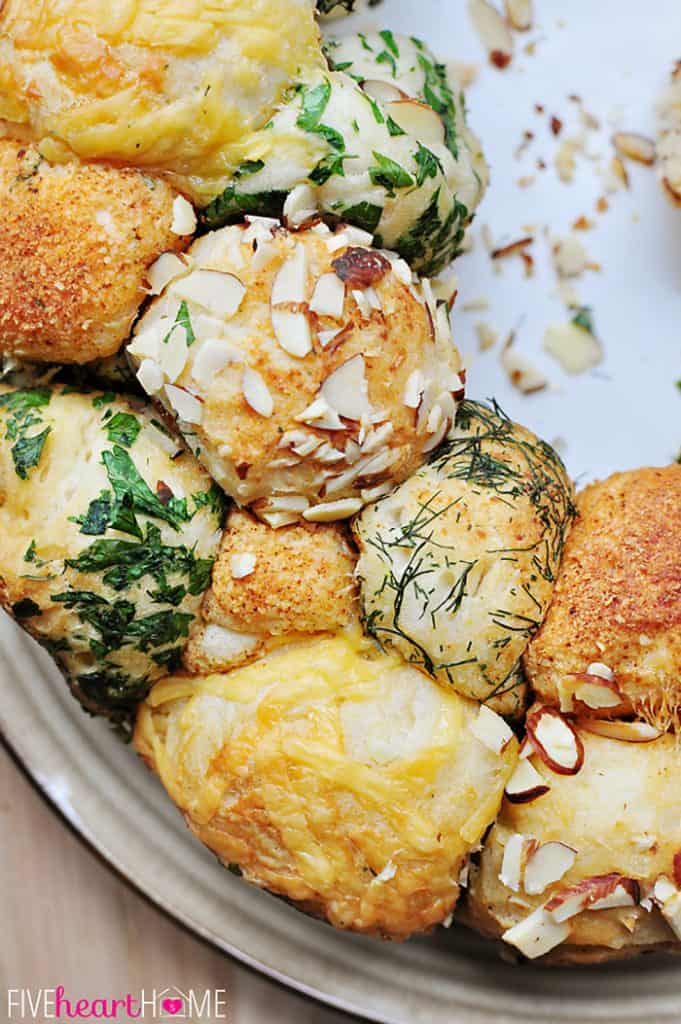 Close-up of Savory Monkey Bread coated with almonds, herbs, Parmesan, and cheddar