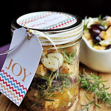 Marinated Cheese in a jar with gift tag.