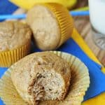 Whole Wheat and Honey Banana Muffins with liner peeled back and bite missing
