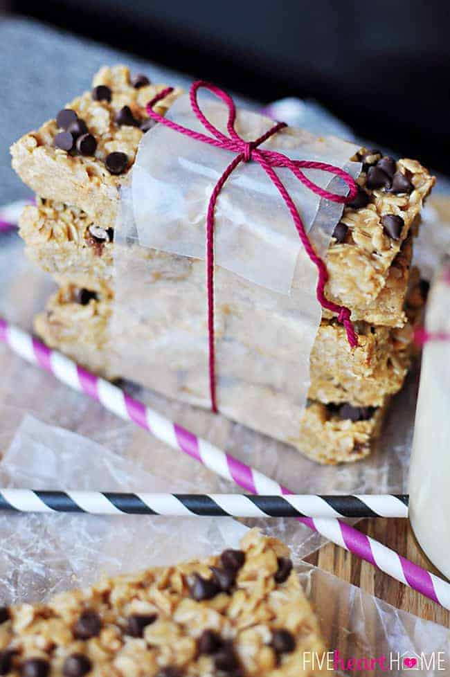 Stack of Chewy No-Bake Granola Bars with Coconut Oil Wrapped in Parchment and Tied with Fucia Twine