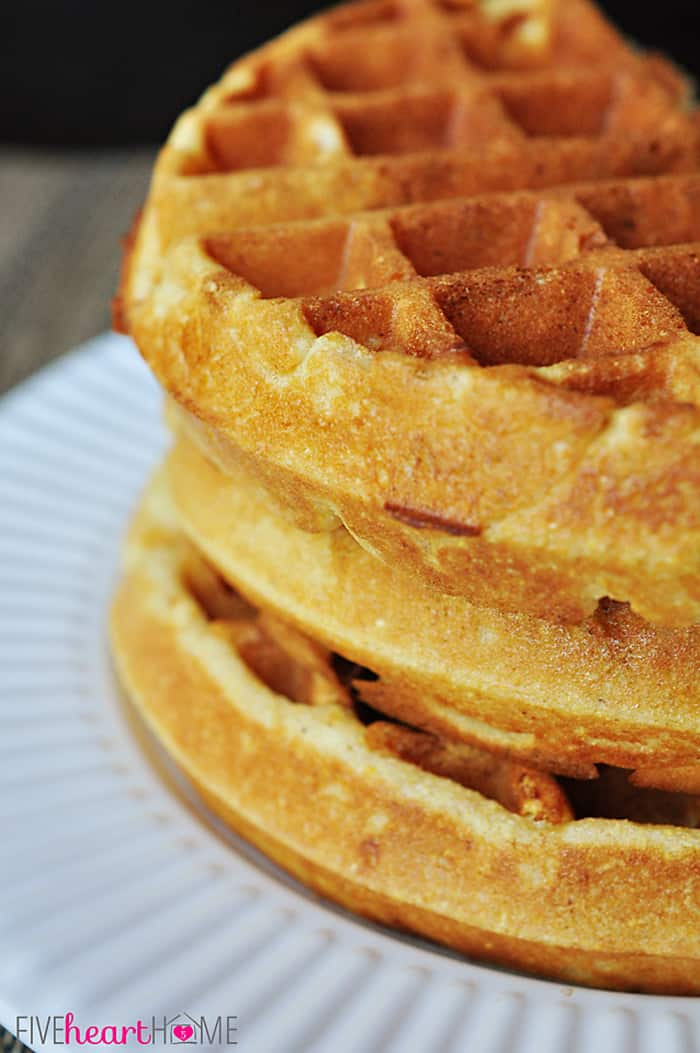 Stack of Cornbread Waffles on a White Plate