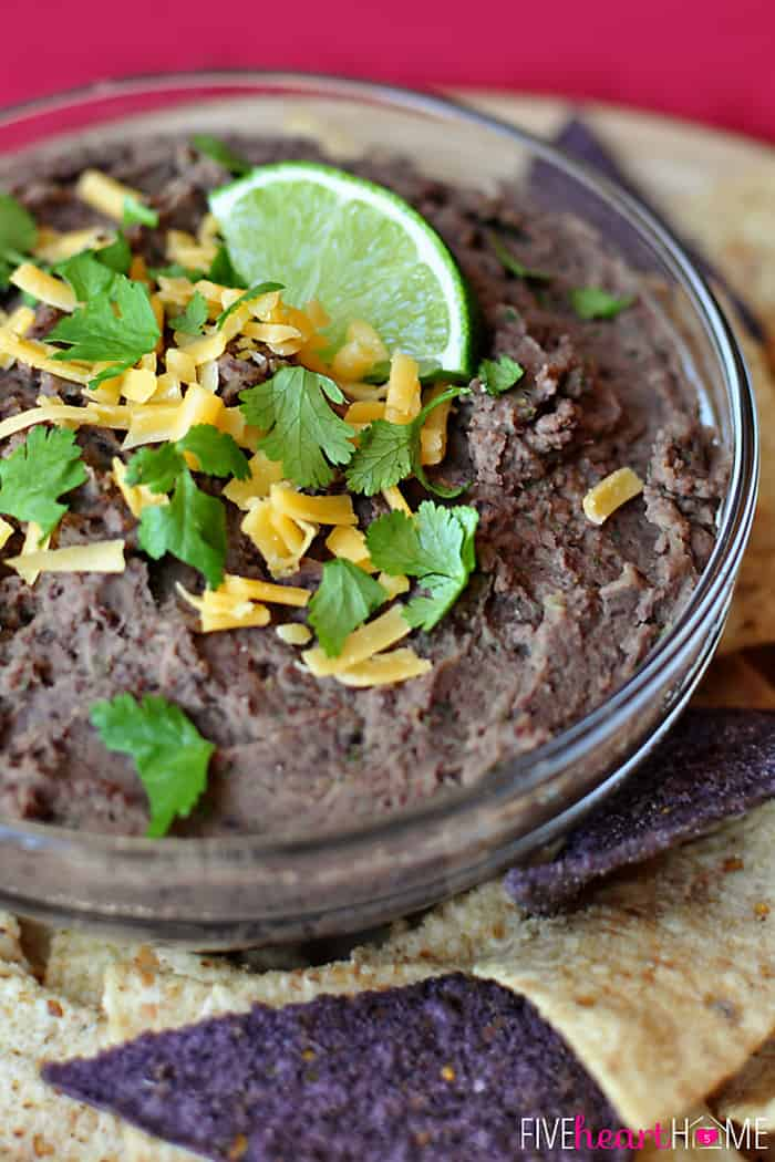 Zesty Black Bean Dip with Garnish of Fresh Cilantro, Grated Cheese and Lime Wedge