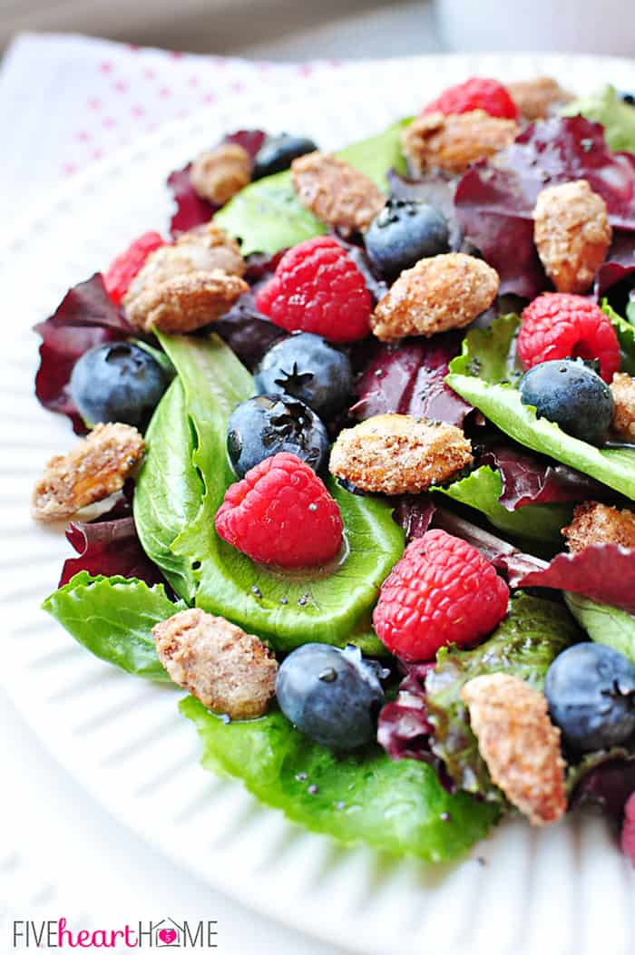 Spring Salad with Mixed Berries, Candied Almonds, and Honey Citrus Vinaigrette ~ a beautiful, delicious salad with vibrant flavors and varied textures | FiveHeartHome.com