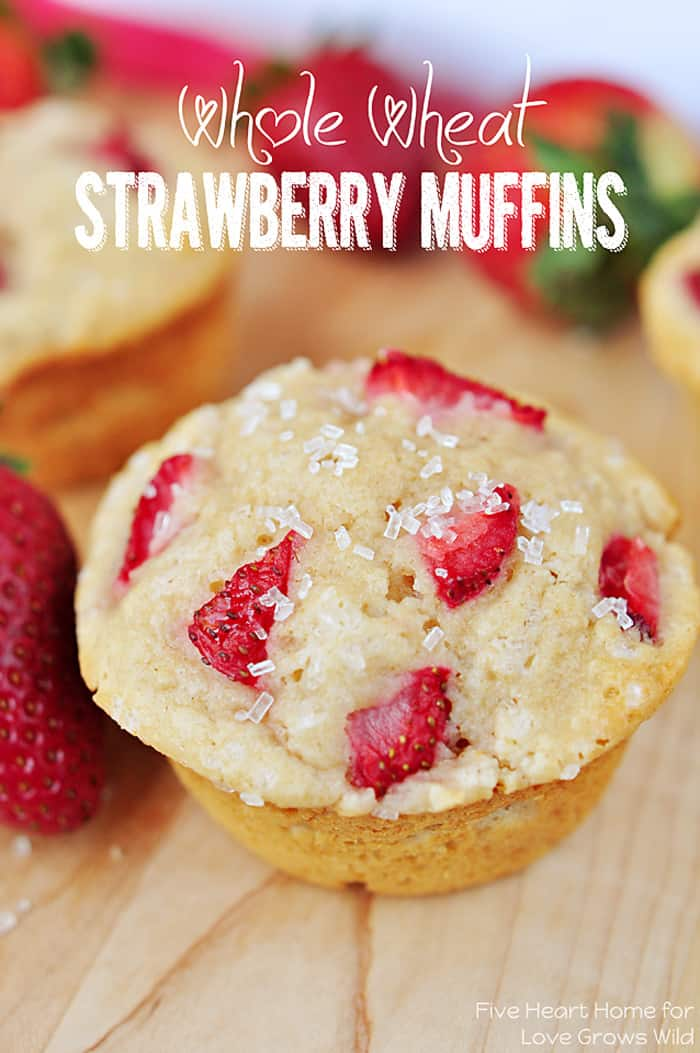 Tender and fluffy Whole Wheat Strawberry Muffins studded with sweet strawberries for a juicy pop in every bite! | LoveGrowsWild.com