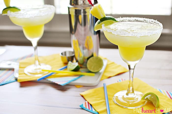 Fresh Pineapple Margaritas ~ made with fresh lime juice and pineapple purée, these are perfect for celebrating Cinco de Mayo or cooling off all summer long! | FiveHeartHome.com