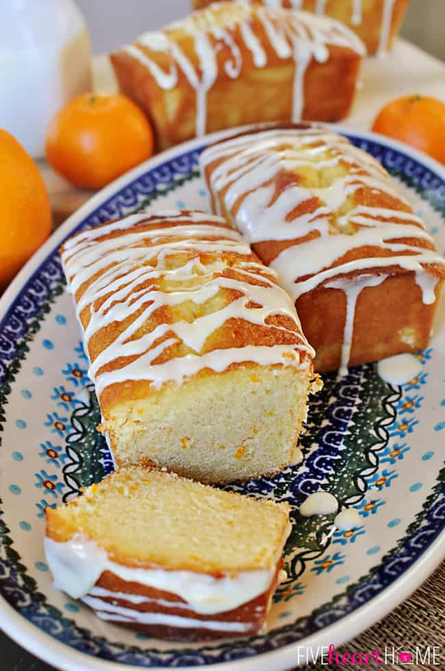 Orange Pound Cake Mini Loaves on Decorative Platter Surrounded by Fresh Oranges