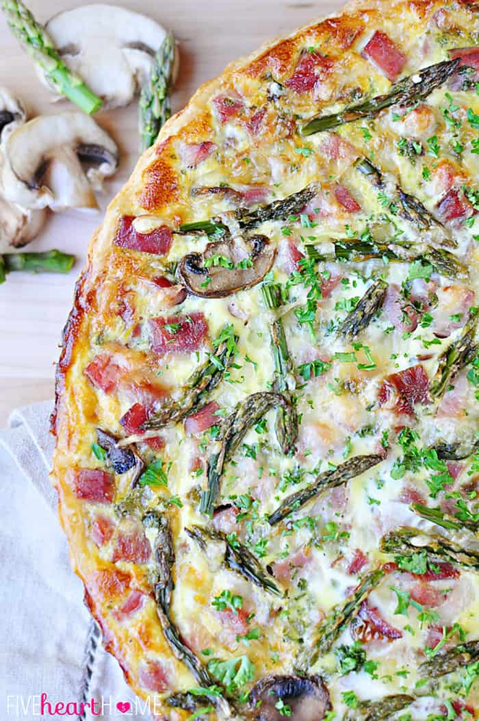 Springtime Asparagus Tart ~ with ham, mushrooms, Swiss, and a buttery crust | FiveHeartHome.com