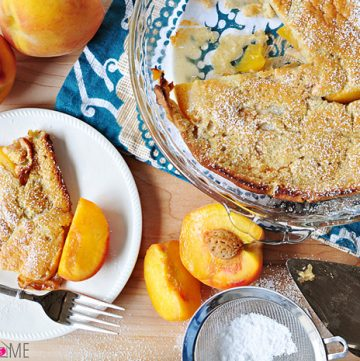 Peach German Pancake (Dutch Baby) ~ golden, puffy, and piping hot skillet pancake studded with peaches | FiveHeartHome.com
