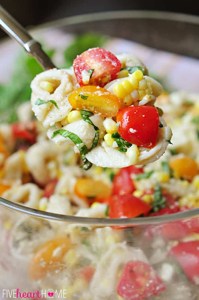 Large Spoonful of Tortellini Pasta Salad with Tomatoes, Basil, and Fresh Corn