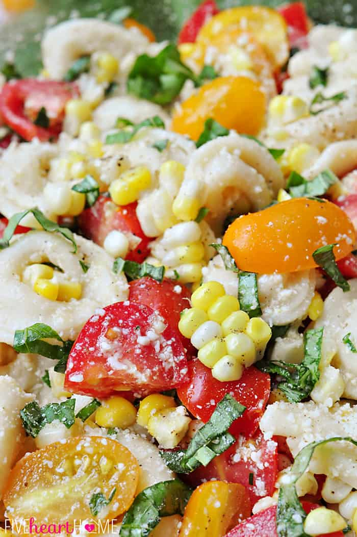 Close-Up of Tortellini Pasta Salad with Tomatoes, Basil, and Fresh Corn