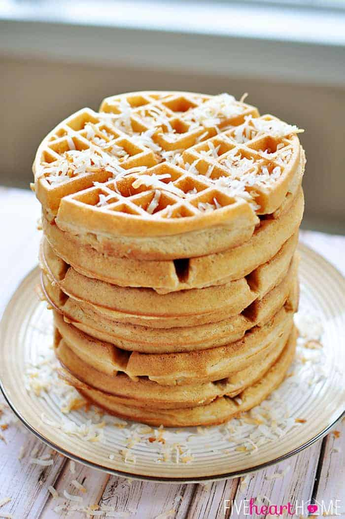 Dairy-Free Coconut Waffles Stacked on a Plate and Topped with Shredded Coconut