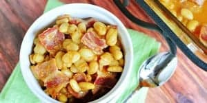 Easy Southern Baked Beans ~ this sweet and savory side dish is topped with bacon, and it's quick to whip up using canned white beans | FiveHeartHome.com