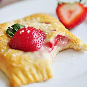 Strawberry Pastry on plate with missing bite.