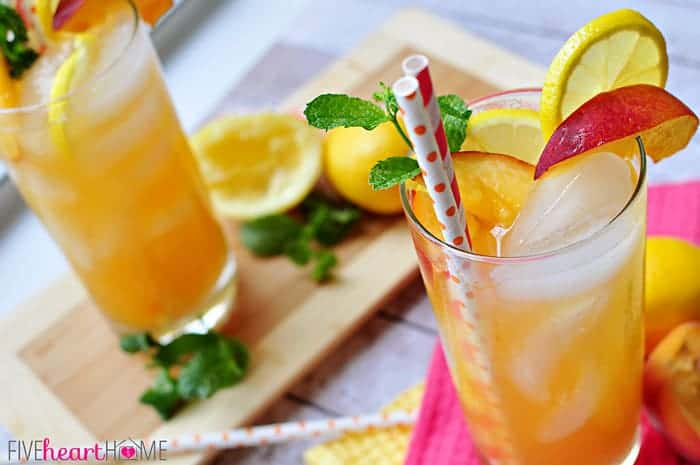 Minty Peach Lemonade with Fresh Fruit and Mint Garnish and Decorative Paper Straws