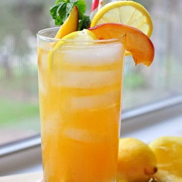 Minty Peach Lemonade ~ homemade lemonade meets mint simple syrup and peach puree in this refreshing summertime drink | FiveHeartHome.com