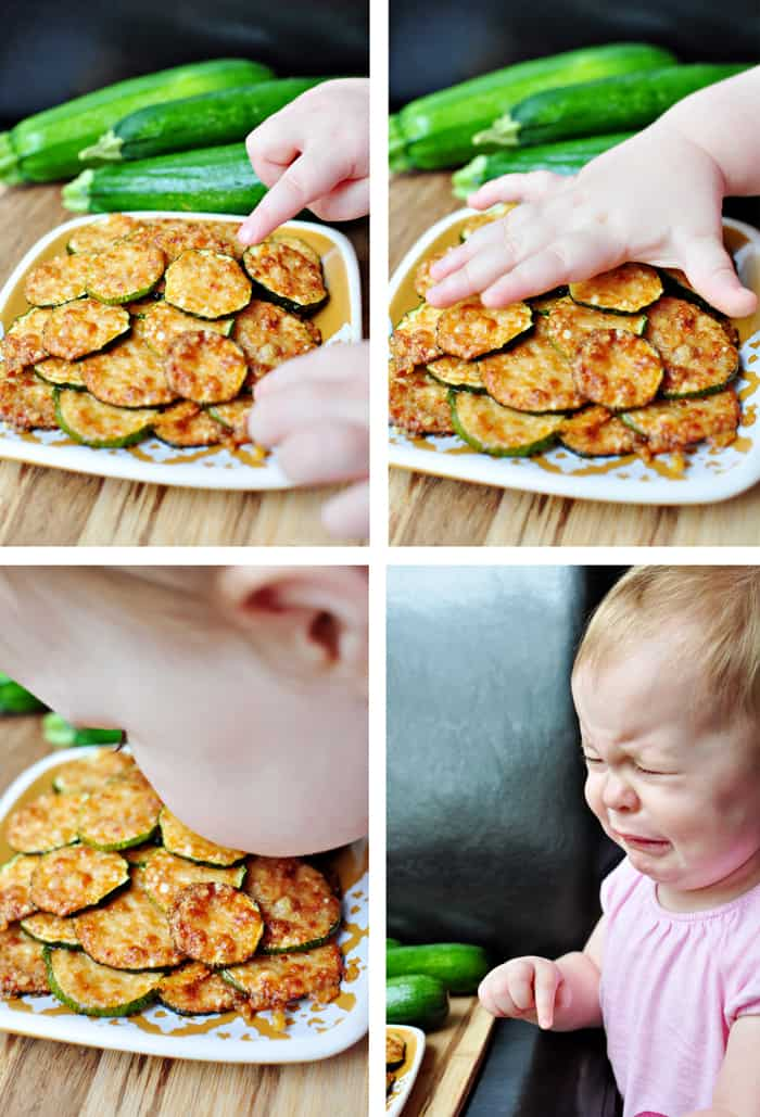 Baby trying to eat zucchini