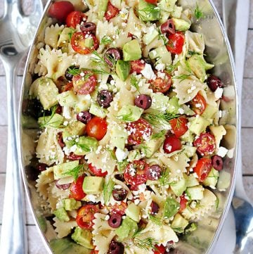 Aerial view of Tomato Cucumber Pasta Salad with Avocado in pewter serving bowl.