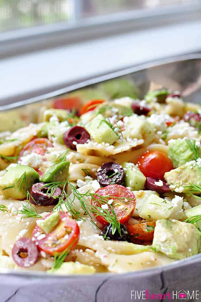 Tomato Cucumber Pasta Salad with Avocado, Kalamata Olives, Feta, and Fresh Dill Close-Up