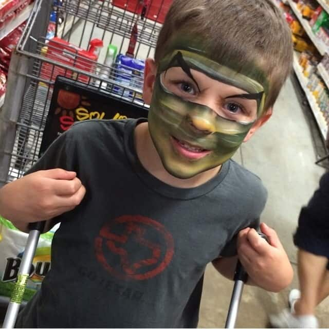 Face-painted Reid Distracting Mom While She Shops for Ingredients