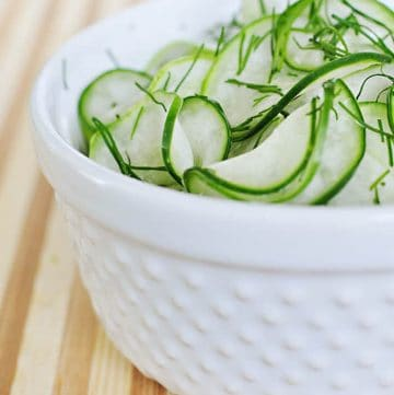 Tangy Cucumber Salad with Fresh Dill ~ thinly-sliced cucumbers in a simple, sweet-and-sour dressing make for a refreshing summer side | FiveHeartHome.com