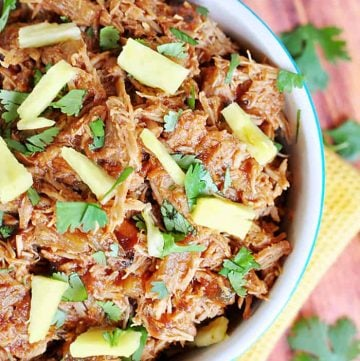 Slow Cooker Pineapple Pulled Pork with Pineapple BBQ Sauce ~ use on tacos, quesadillas, pizza, nachos, and more! | FiveHeartHome.com