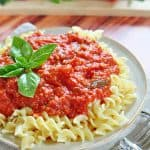30-Minute Marinara Sauce with Fresh Tomatoes over plate of pasta.