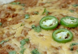 Warm and Cheesy Bean Dip ~ quick and easy, full of flavor, and also makes a great side dish or filling for tacos, burritos, quesadillas, and more! | FiveHeartHome.com