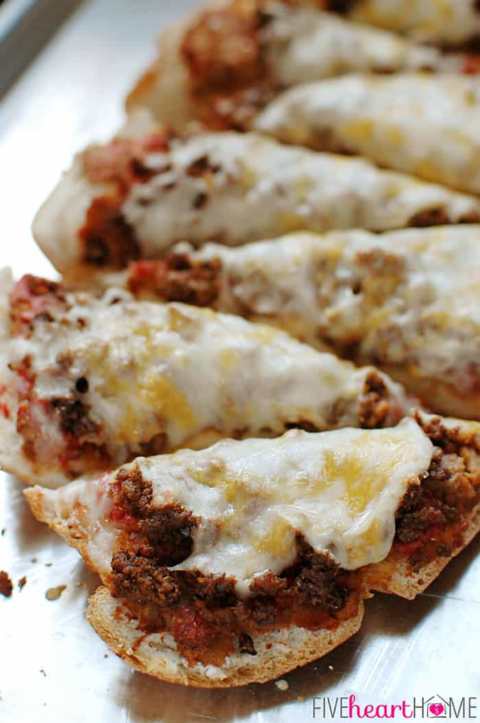 Slices of Pizza with Refried Beans, Taco Meat and Melted Cheese
