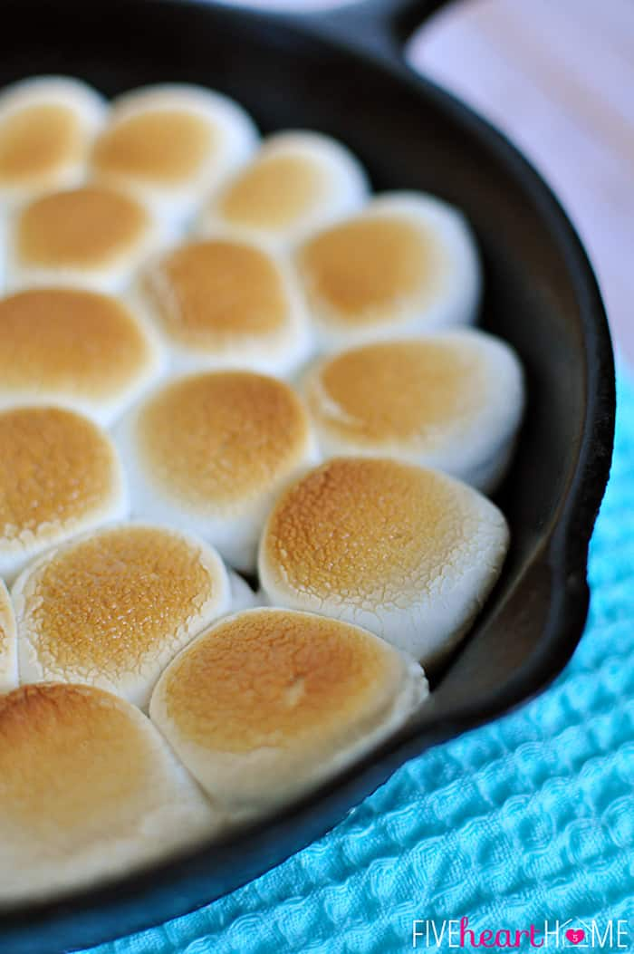 S'mores Dip ~ melted chocolate and toasty marshmallows bake up in a skillet; scoop up with graham crackers for a perfect party dessert! | FiveHeartHome.com