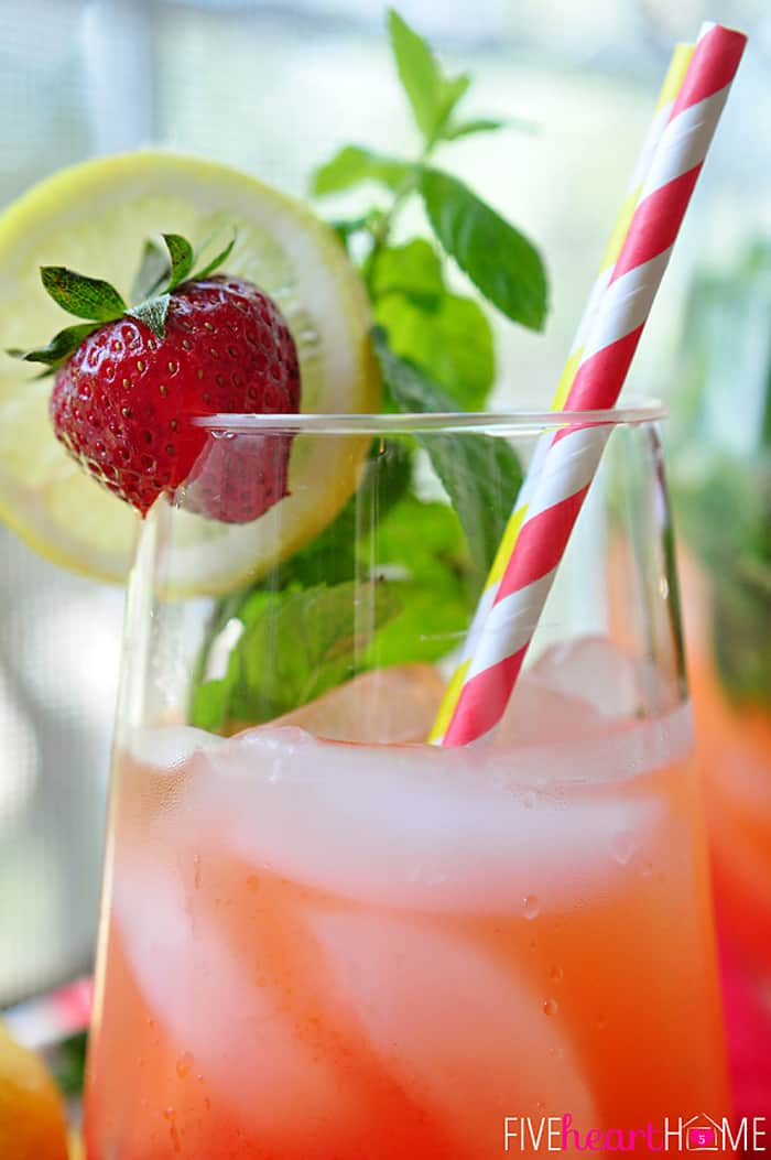 In a Frosty Glass with Fresh Garnish of Strawberries, Lemon and Mint