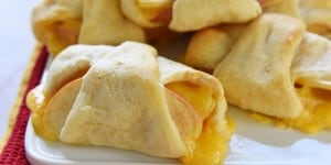 Apple Cheddar Crescents ~ a sweet and savory snack or lunch idea featuring golden crescent rolls wrapped around melted cheddar and tender apples | FiveHeartHome.com