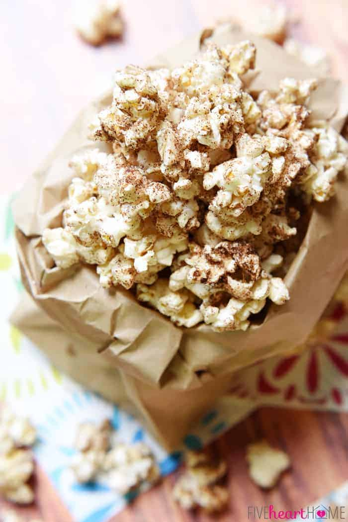 Aerial View with Popcorn Overflowing from Brown Paper Bag