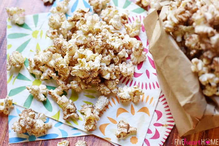 Brown Butter Cinnamon Sugar Popcorn Served in a Paper Bag and on Decorative Napkins