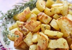 Garlic and Herb Roasted Potatoes ~ a simple, delicious side dish flavored with fresh rosemary and thyme | FiveHeartHome.com