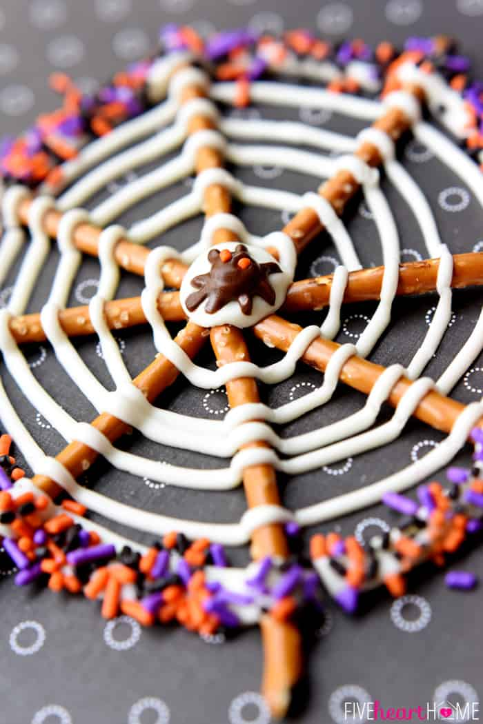 Spiderweb Halloween Pretzel Treat decorated with orange, black, and purple sprinkles