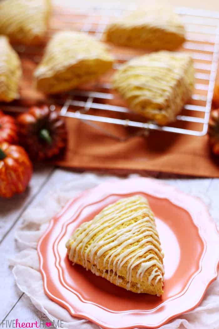 Fall Treat of Pumpkin Scones with Brown Butter Glaze on a Scolloped Coral Plate