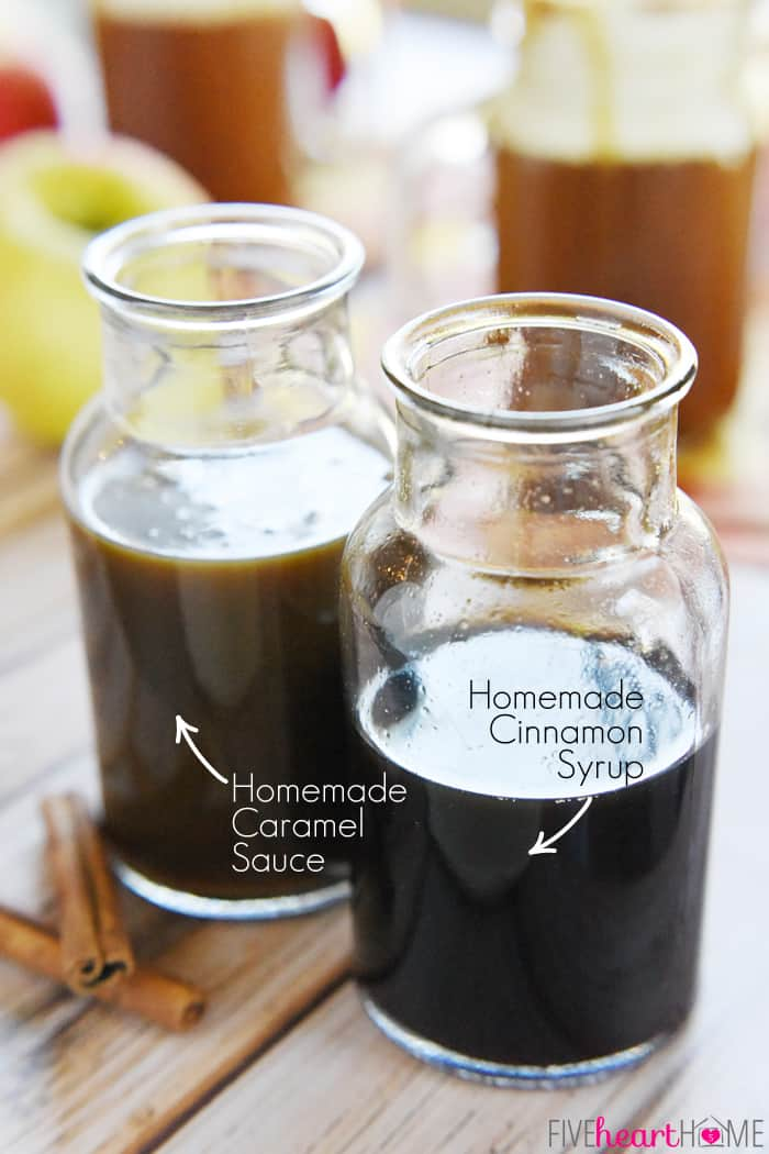 Two Glass Jars Labeled Homemade Caramel Sauce and Homemade Cinnamon Syrup